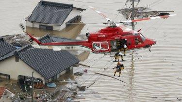 A resident is rescued in a flooded area in Kurashiki, Okayama prefecture, following heavy rain.