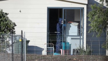 Police forensics investigate the death of seven people in a suspected murder-suicide in Osmington on Friday.