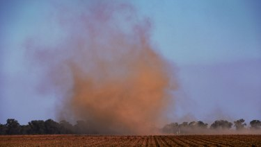 Wind whips up the dust over a dry farm in the Deniliquin region - a region that baked again on Wednesday.
