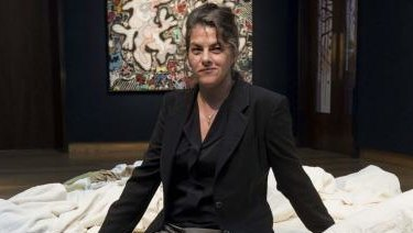 Tracey Emin sits on her iconic art installation, My Bed, which was short-listed for the 1999 Turner Prize.