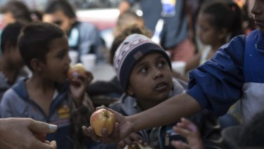 Children wait for breakfast at a migrant shelter in Tijuana, Mexico, on April 28.