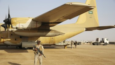 A Saudi soldier guards an aid flight at an air base in Marib, Yemen earlier this month.