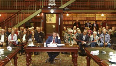 Mike Baird gives evidence before a packed public gallery.