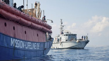 Lifeline is reached by a Libyan Coast Guard boat after rescuing migrants from a rubber boat in the Mediterranean Sea on Thursday.