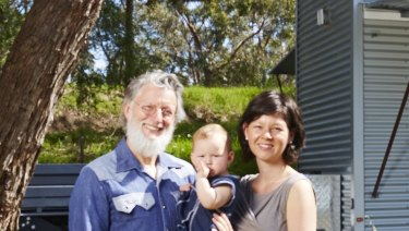 Fred Schultz, wife Shannon and daughter Olina with the tiny home Mr Schultz built.