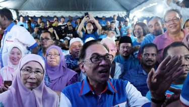 Deputy Prime Minister Wan Azizah (left) with her husband Anwar Ibrahim at a rally in his first speech after being released from prison in Kuala Lumpur.