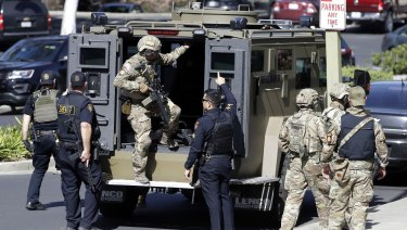 Officers exit an armored vehicle outside YouTube headquarters on Tuesday.