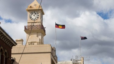 Flags flying over Richmond Town Hall, where Yarra Council took its vote in August.