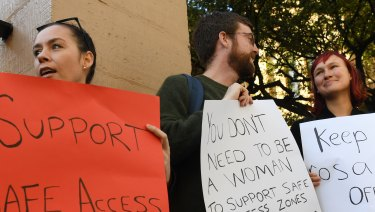 Demonstrators in favour of safe access zones around NSW abortion clinics stand outside NSW State Parliament last month.