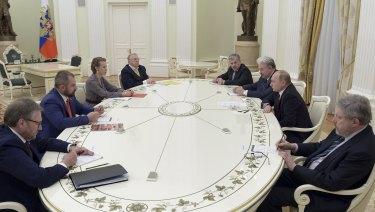 Putin, second right, meets with opposition candidates who ran against him in Sunday's presidential election, from left: Boris Titov, Maxim Suraykin, Ksenia Sobchak, Vladimir Zhirinovsky, Pavel Grudinin, Sergei Baburin, and Grigory Yavlinsky at the Kremlin.