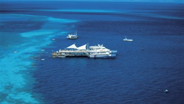 The helicopter crashed near a tourist pontoon at Hardy Reef in the Whitsundays.
