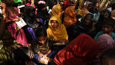 Women and children queue at a Red Cross distribution point in Burma Para refugee camp in Bangladesh.