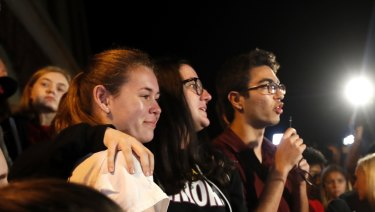 Diego Pfeiffer, a student survivor from Marjory Stoneman Douglas High School, speaking to a crowd of supporters and media, with fellow survivors Sophie Whitney, left, and Sarah Chadwick.