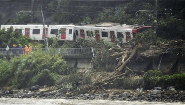 A train remains derailed by a landslide caused by heave rains in Karatsu, Saga prefecture, Japan, on Saturday.