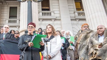 Boon Wurrung elder Carolyn Briggs, with Greens MP Lidia Thorpe, reads a statement criticising Victoria's Aboriginal treaty negotiations as flawed.