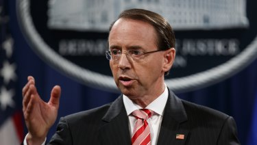 Deputy Attorney-General Rod Rosenstein speaks during a news conference to announce the charges at the Department of Justice in Washington.