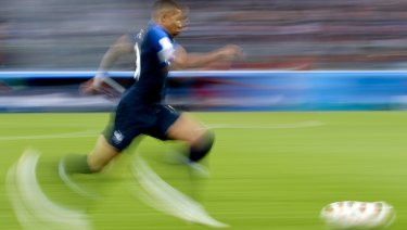 Bleus blur: Mbappe runs with the ball against Belgium in the semi-final.