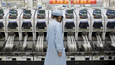A ZTE employee at its factory in Shenzhen.