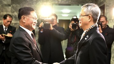 The head of the North Korean delegation, Kwon Hook Bong, shakes hands with his South Korean counterpart, Lee Woo-sung, before their meeting at the North side of Panmunjom in North Korea on Monday.