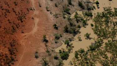 Flood waters from the Warrego River fill channels in the Cuttaburra Creek in 2007.