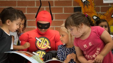Deadly Dan reads to children at Yappera Children's Services.
