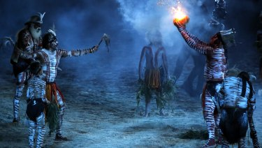 Aboriginal Australians perform a smoking ceremony during the opening ceremony for the Commonwealth Games.