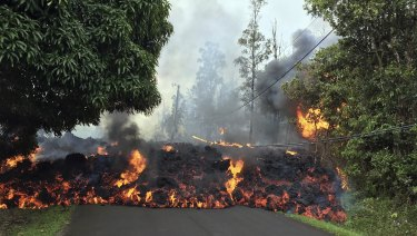 A lava flow moves across Makamae Street in the Leilani Estates subdivision near Pahoa on the island of Hawaii.