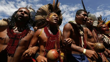 Brazilian Indigenous people from various ethnic groups take part in a protest against the government's land demarcation policies.