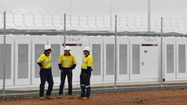 Construction workers at the launch of Tesla's 100 megawatt lithium-ion battery at Jamestown, north of Adelaide.