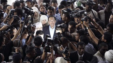 Then Malaysian opposition leader Anwar Ibrahim, centre, is surrounded as he arrives at court in 2008.