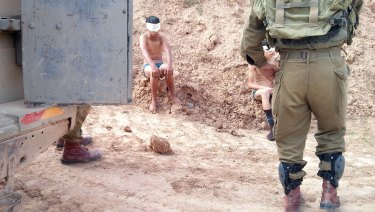 Children are blindfolded and handcuffed by soldiers and taken to police stations.  Photo taken by IDF soldier on a occupied territory mission.