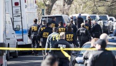 Authorities investigate the scene of Monday's second explosion.