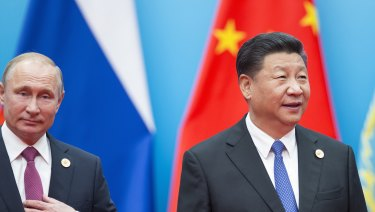 Chinese President Xi Jinping, right, and Russian President Vladimir Putin walk to attend talks at the Shanghai Cooperation Organisation.
