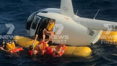 Four people were rescued after their helicopter made an emergency landing in the Whitsundays.
