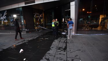 Water was pouring out of the apartment building entrance.