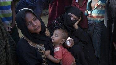 Rohingya refugee women queue up outside a relief distribution centre Cox's Bazaar, Bangladesh.