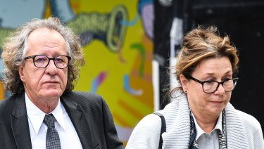 Geoffrey Rush and wife Jane Menelaus outside the Federal Court in Sydney on Wednesday.