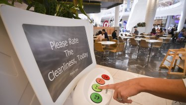 A customer registers their feedback via a HappyOrNot terminal in the Chadstone Shopping Centre food court.