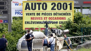"""Investigators with the helicopter used by the French criminal known as """"The Writer""""."""