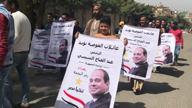 Voters are bused in from other districts to vote at Heliopolis, an upmarket Cairo suburb.
