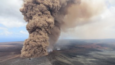A red-brown ash plume steams from the Hawaiian volcano.