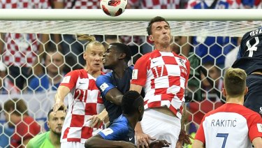 Croatia's Mario Mandzukic scores at the wrong end.