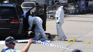 Forensic police at the scene of the shooting.