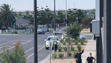 Police storm Point Cook after shooting on Monday.
