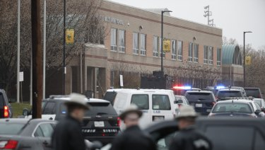 Police converge at the school which was on lockdown.