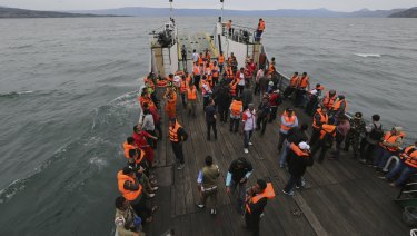 An Indonesia search and rescue team searches for a ferry which sank in Lake Toba, Sumatra.