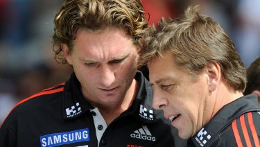 James Hird and Bomber Thompson working together in 2011.