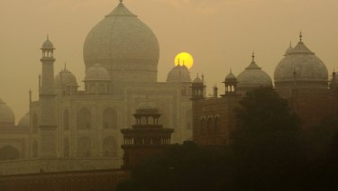 Insects proliferating from a polluted river near the Taj Mahal have left greenish black spots on the walls.