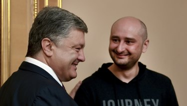 Ukrainian President Petro Poroshenko, left, and Russian journalist Arkady Babchenko meet in Kiev on Wednesday.