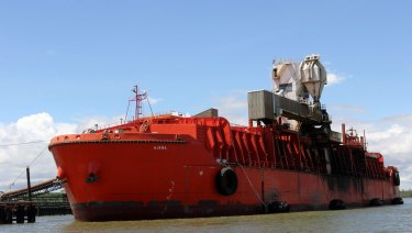 A ship is loaded with copper-gold concentrate from Freeport McMoRan Inc.'s Grasberg copper and gold mine at the company's loading facility in the port of Amamapare, Papua province, Indonesia.